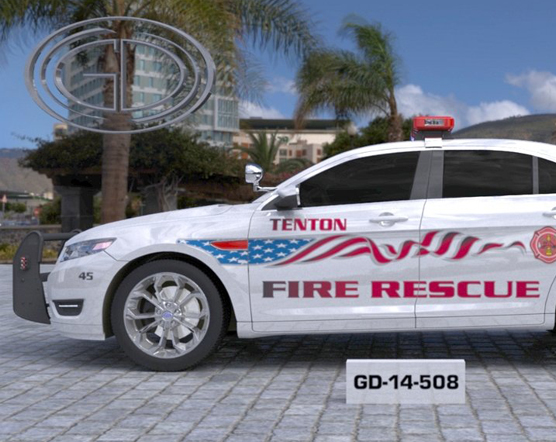 tenton white fire rescue car with american flag design parked near the tree