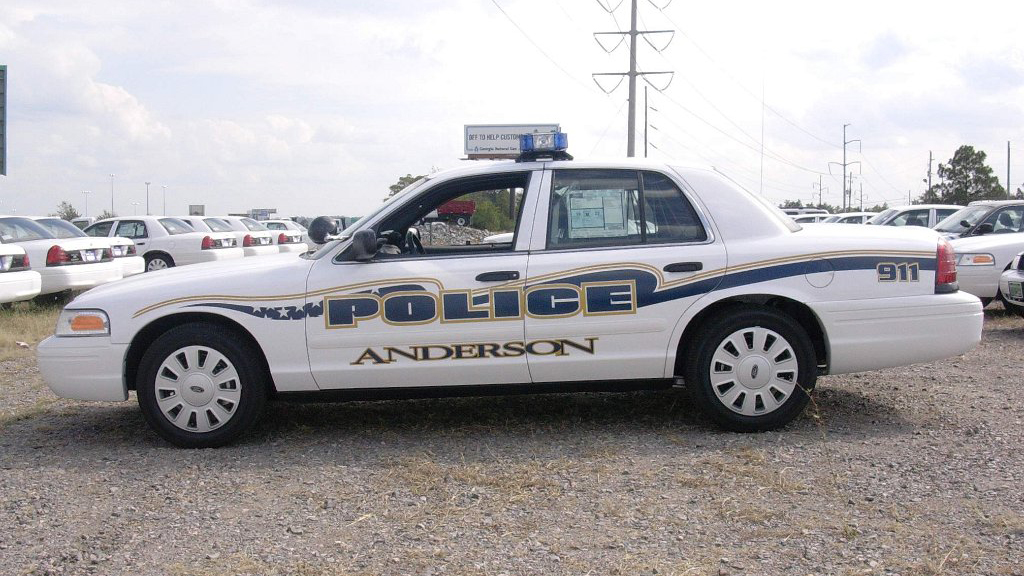 anderson police car parked with blue and yellow line design