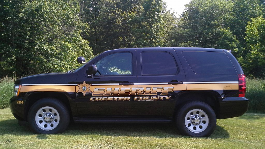 sideview design of sheriff chester country black car
