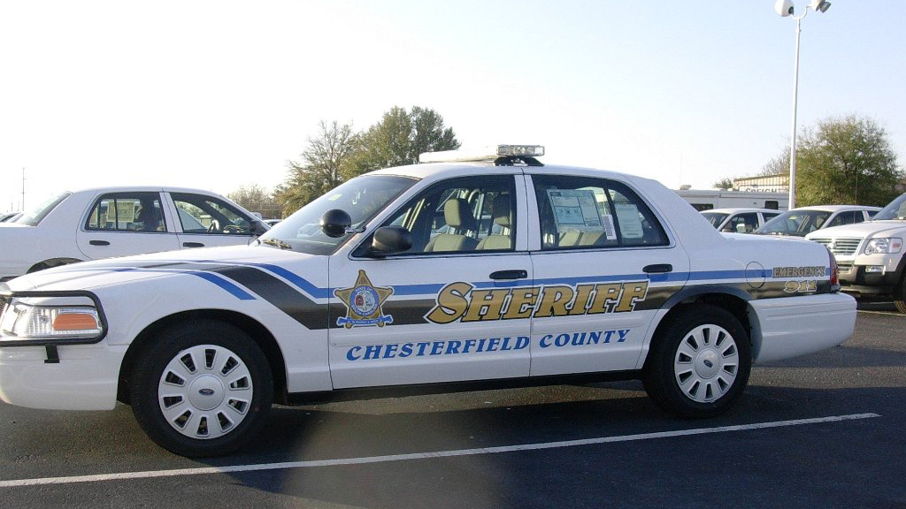 white sheriff car with gold and blue font design