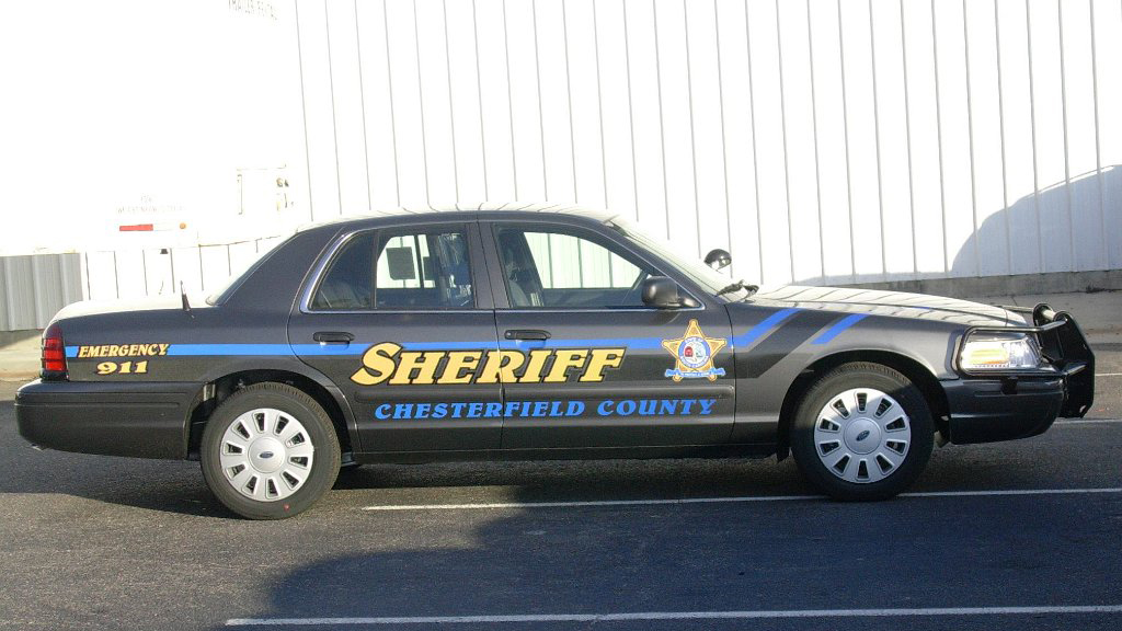 black sheriff car with logo and blue font color