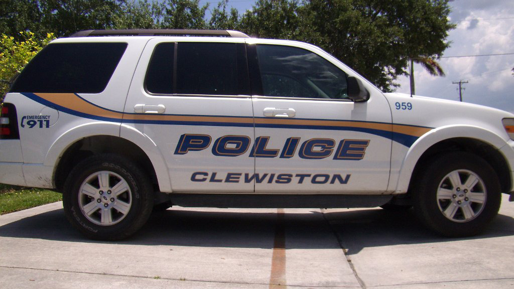 clewiston white police car with orange and blue line design