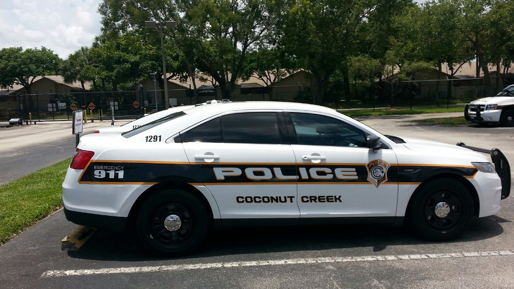 sideview design of a coconut creek police car