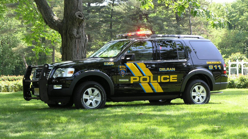 sideview of a black designed delran police suv car