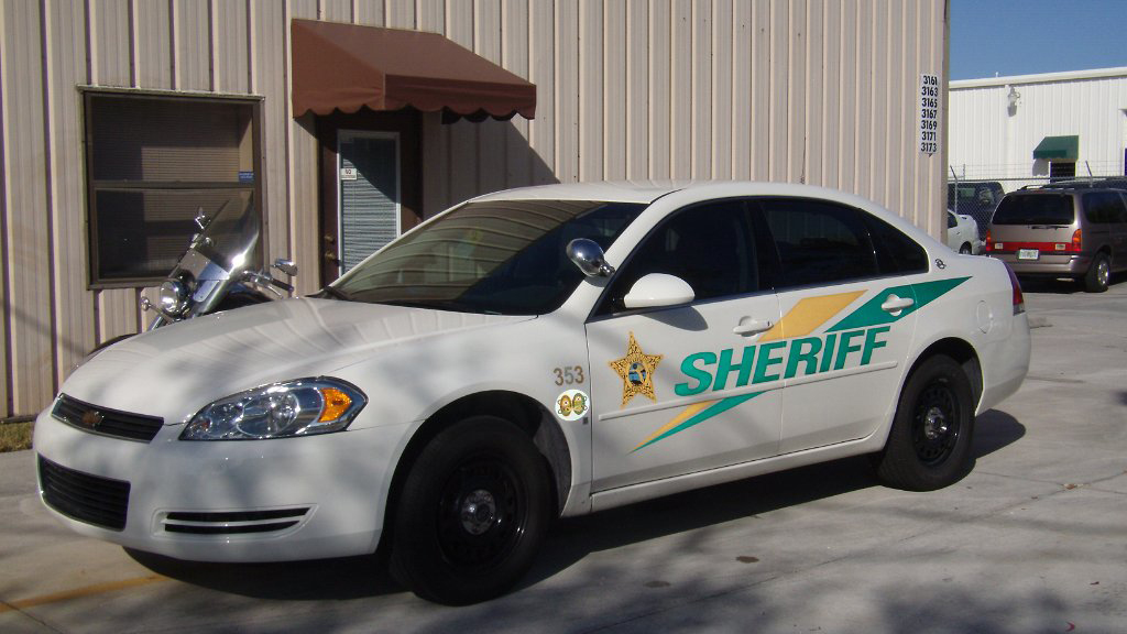 white sheriff car with yellow and green line design