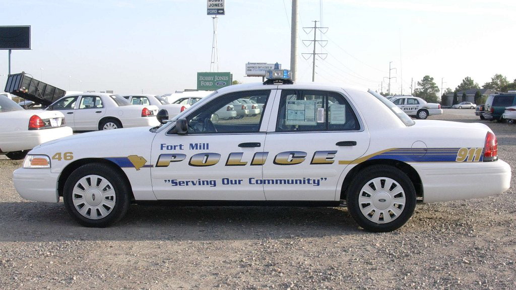 white fort mill police car with blue font and line design