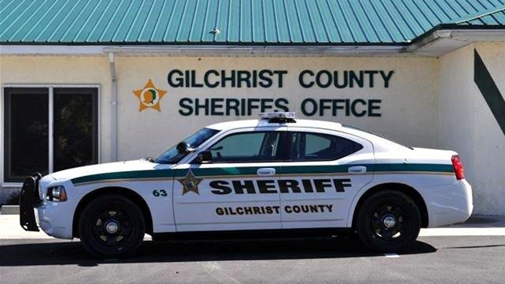white gilchrist sheriff car with green and yellow line design