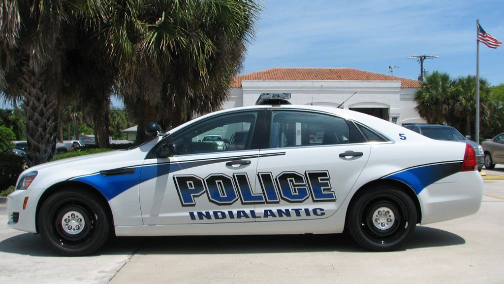 indialantic white police car with blue font and line design