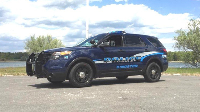sideview of a dark blue designed kingston police suv car