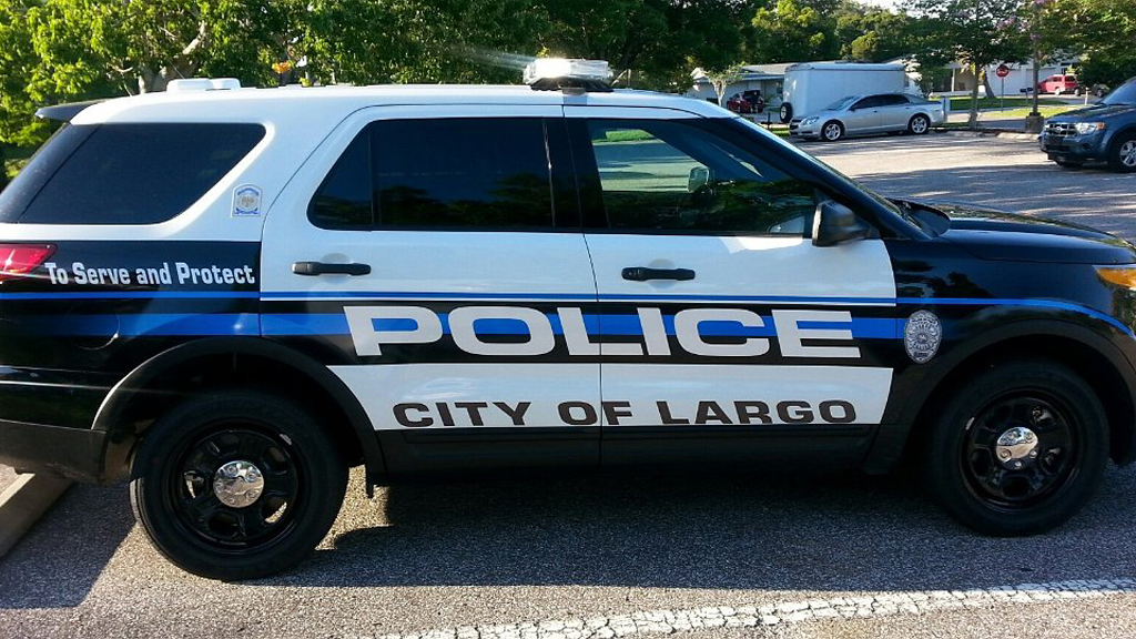 large font of police in a graphic design of largo police car