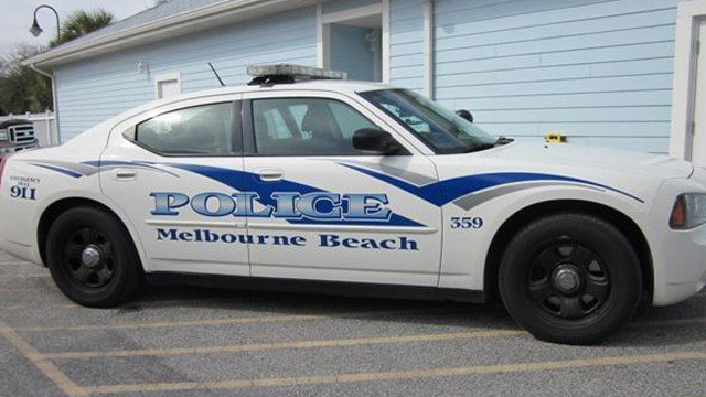 white and blue graphic design of melbourne police car
