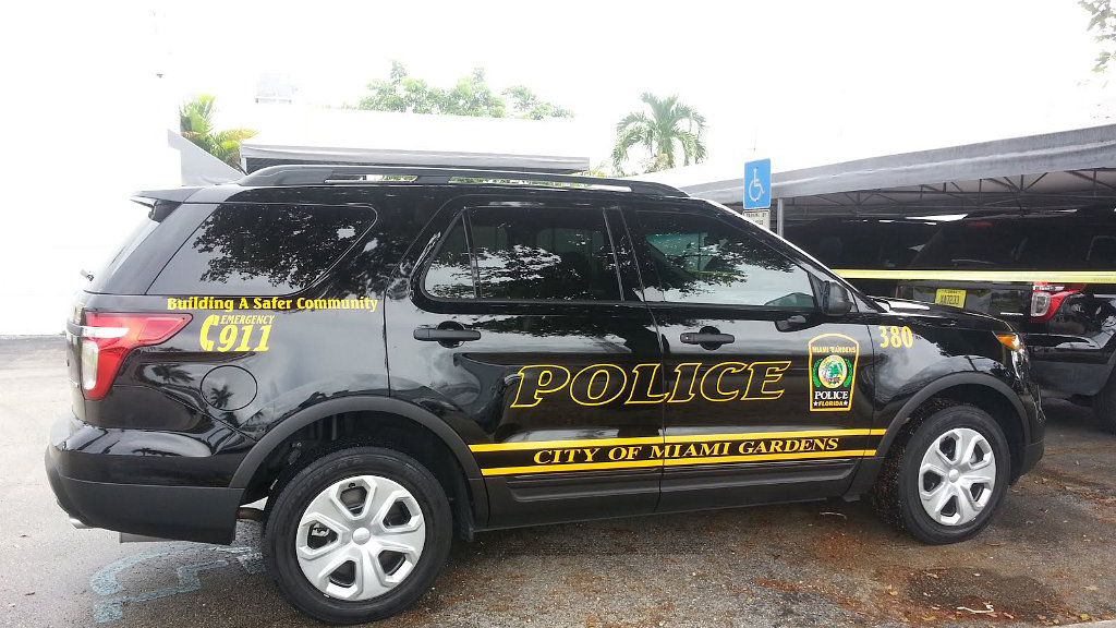 sideview of a black designed police suv car city of miami gardens