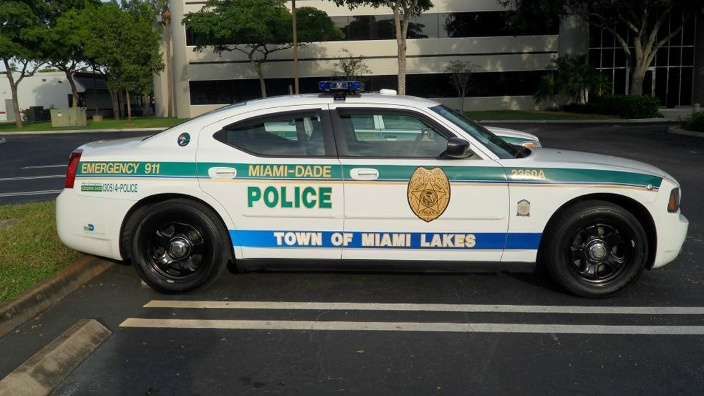 sideview design of a miami - dade police car