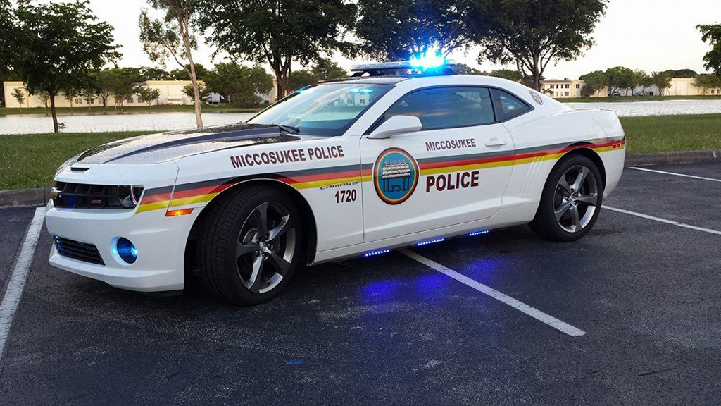 miccosukee police white car with black, red and yellow line design