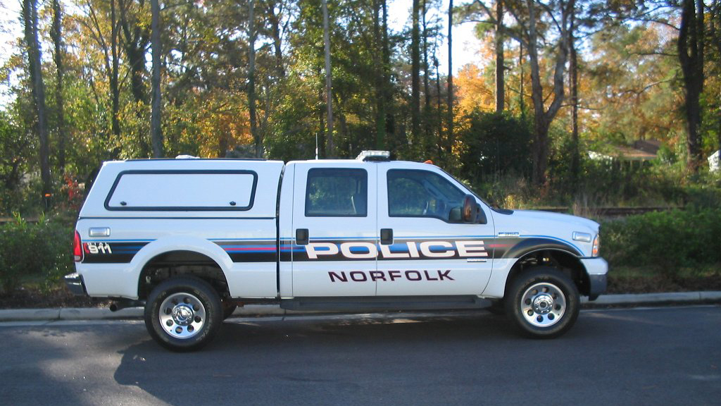 norfolk police white car with stripe line of blue and black