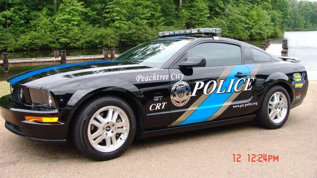 parked peachtree city police car with grey and sky blue design
