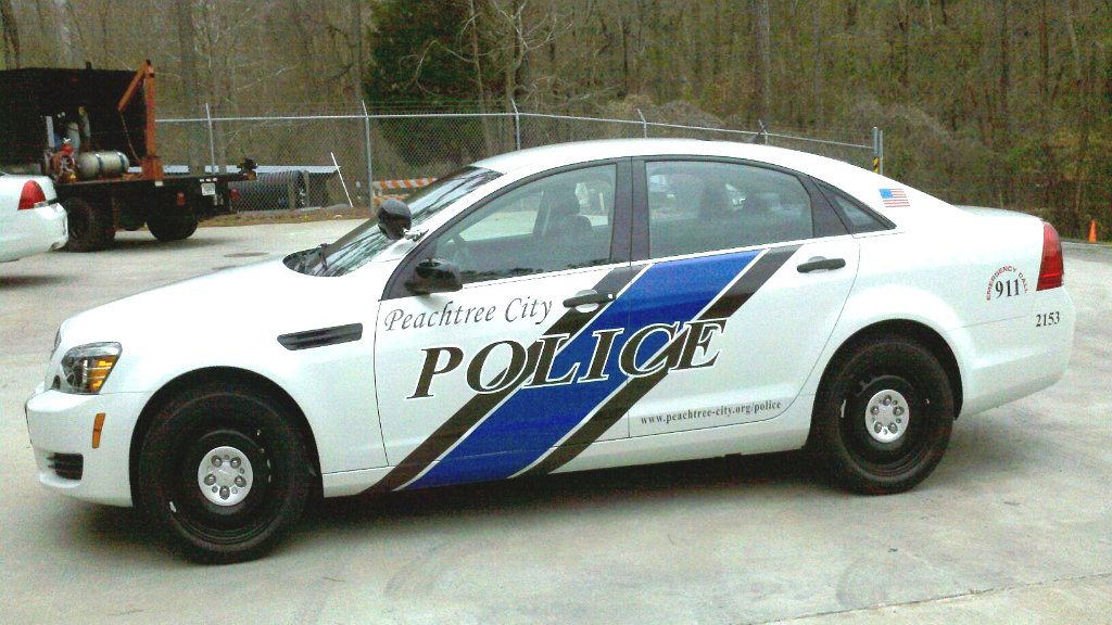 white peachtree police car with black and blue design