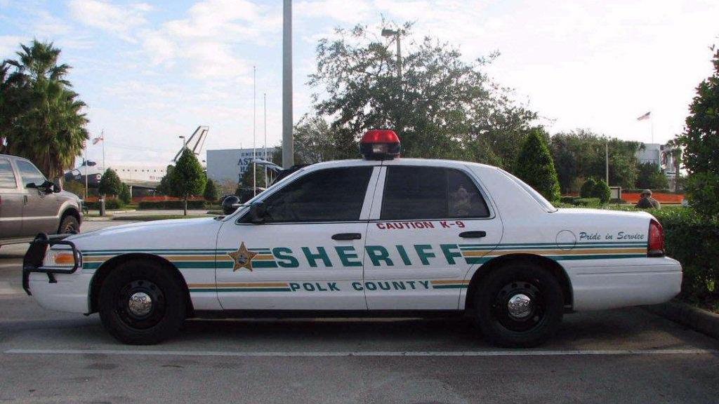 white polk county sheriff car with green and yellow line design