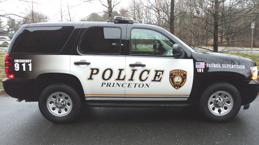 black police car with white and yellow graphic design
