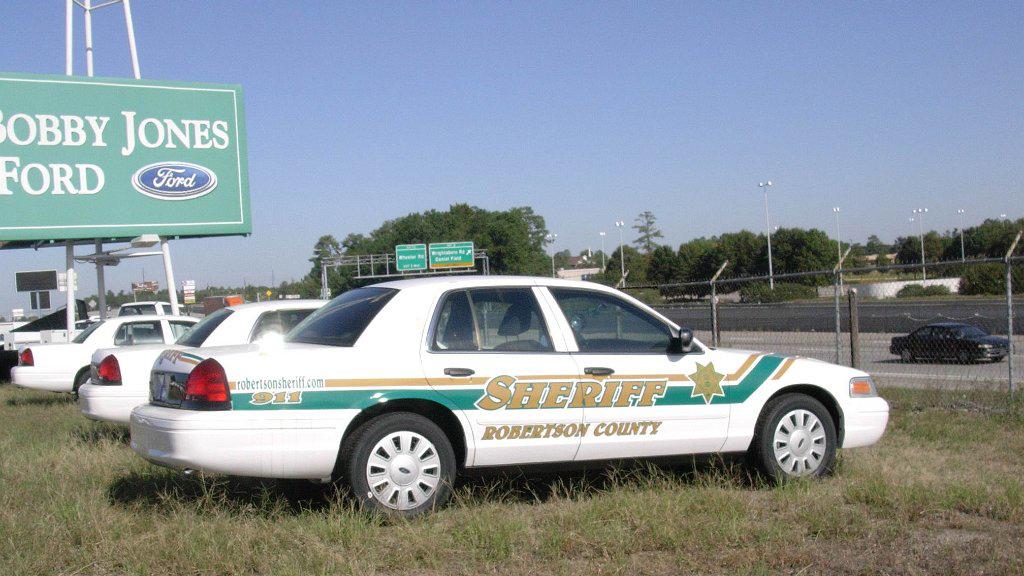 white sheriff car parked at bobby jones for