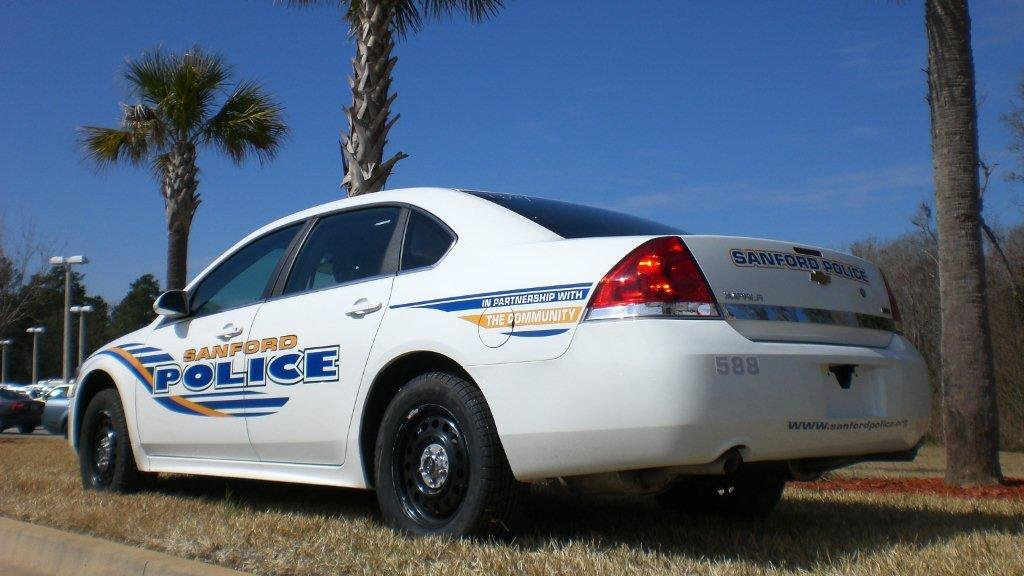 sanford police car with yellow and blue font color graphic design