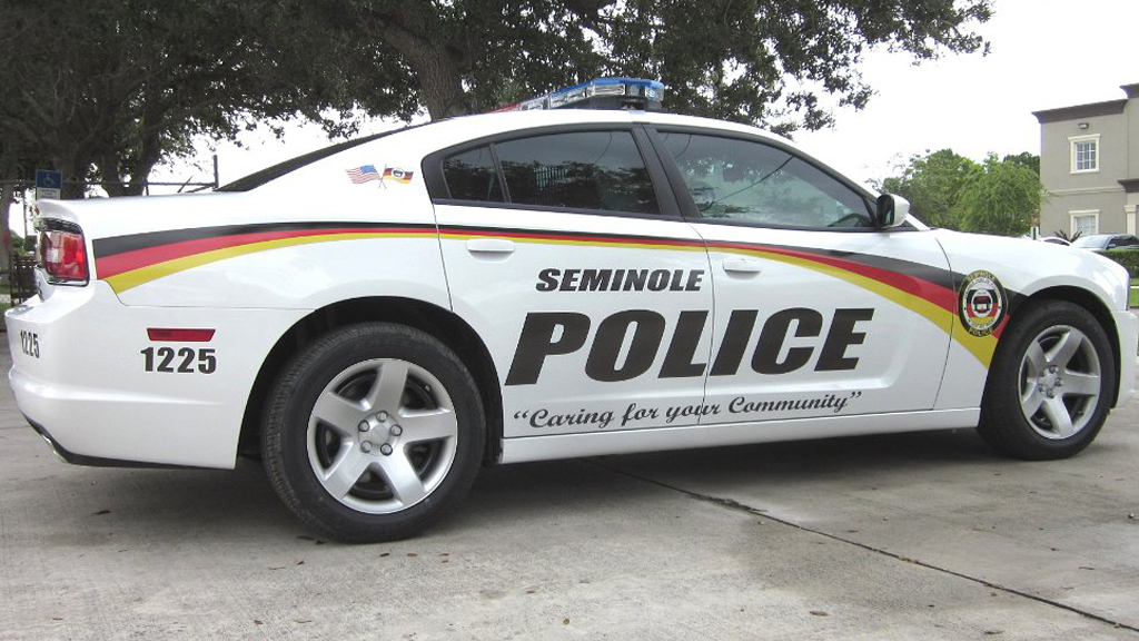 white seminole police car with red and yellow color line design