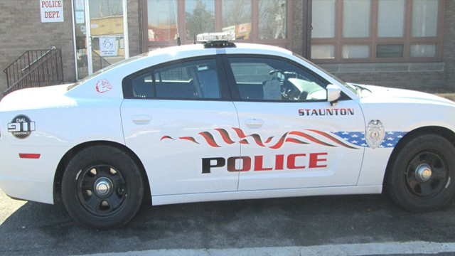 white car with black and red police font style design