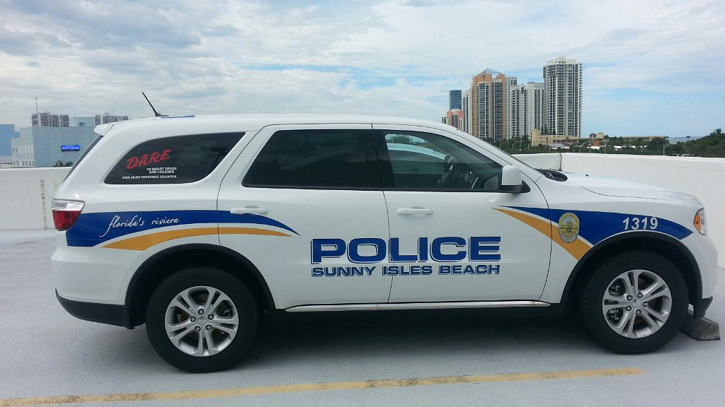sunny isles beach police car parked in a rootop.