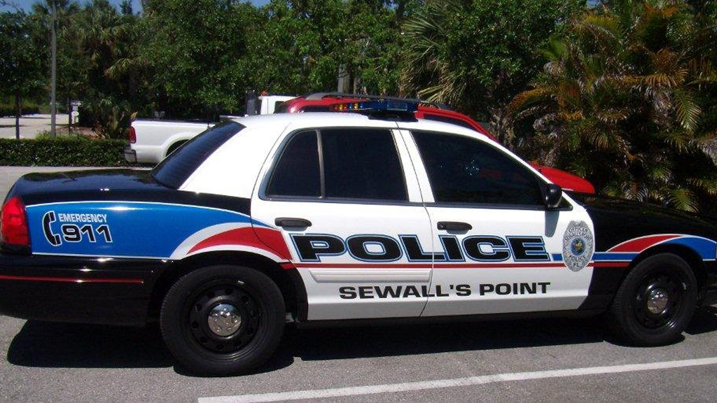sewalls point police white car with blue and red line design