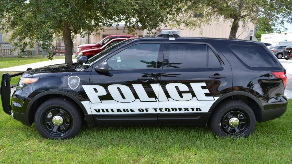 tequesta black police car with white font design