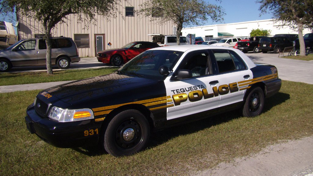 black and white tequesta police car with gold font and line design