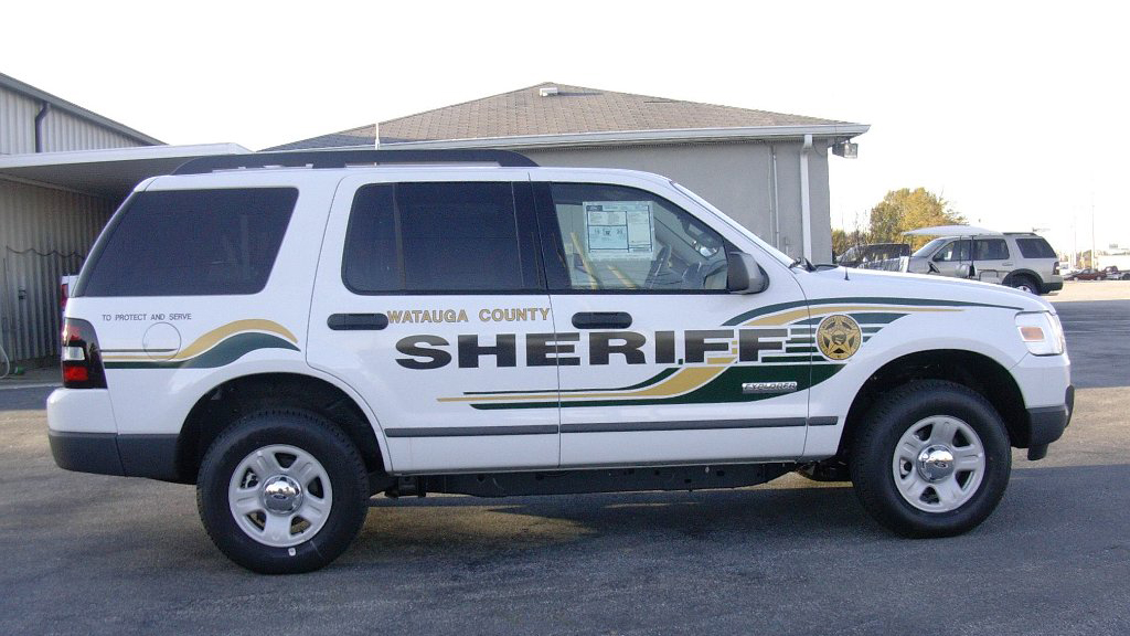 watauga sheriff white car designed with green and gold color lines