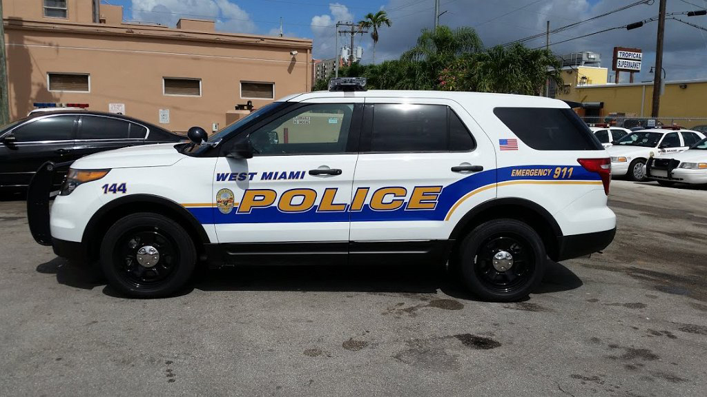 white west miami police car with yellow and blue combination colors with us logo