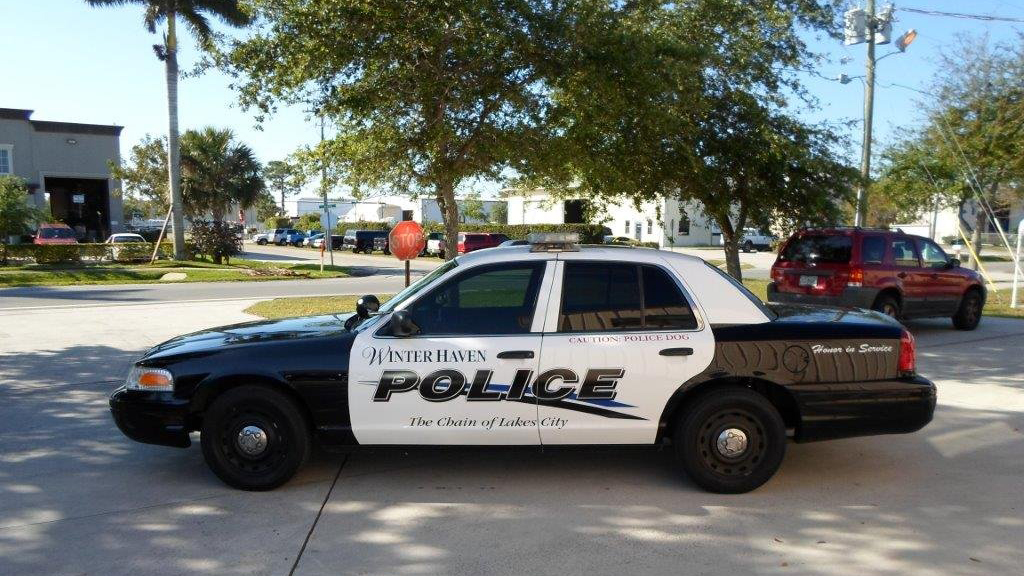 winter haven police black and white car parked near the tree