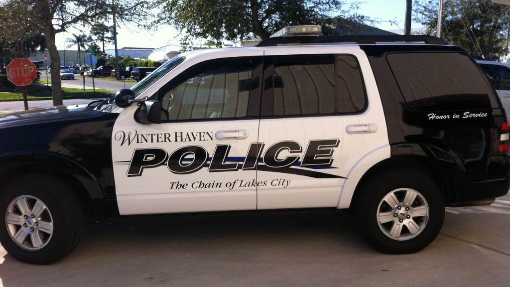 black and white winter haven police car with blue line design
