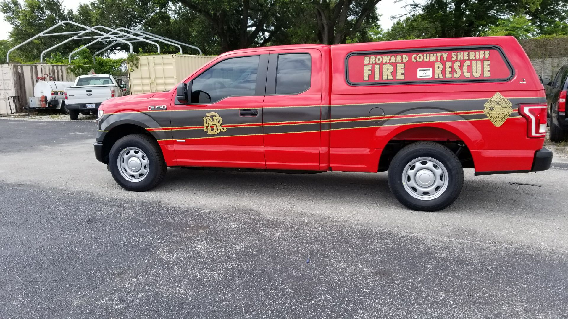 sideview design of a red broward county sheriff fire rescue car